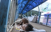 This foot overbridge at one of the capital's busiest intersections, Shahbagh, has become a resting place for the city's transients and the low-income people. Photo: tanvir ahammed/ bdnews24.com
