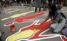 A group of artists paint a street near Central Shaheed Minar in Dhaka protesting against a scheduled function to be held there to pay last respects to Prof Piash Karim. Photo: asif mahmud ove/ bdnews24.com
