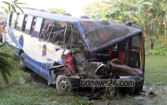 Mangled remains of the ill-fated bus, which collided with another bus on Monday killing at least 34 people, lying beside the Dhaka-Rajshahi highway. Photo: bdnews24.com