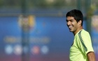 Luis Suarez smiles during Barcelona's training session at Joan Gamper training camp on October 20, 2014. Reuters