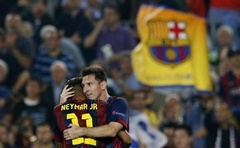 Lionel Messi (R) is congratulated by Neymar after scoring a goal against Ajax Amsterdam during their Champions League match at the Camp Nou in Barcelona October 21, 2014. Reuters