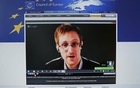 Accused government whistleblower Edward Snowden is seen on the computer screen of a journalist on the internet site of the Council of Europe, as he speaks via video conference with members of the Committee on legal Affairs and Human Rights of the Parliamentary Assembly of the Council of Europe during an hearing on ''mass surveillance'' in Strasbourg, April 8, 2014. Reuters