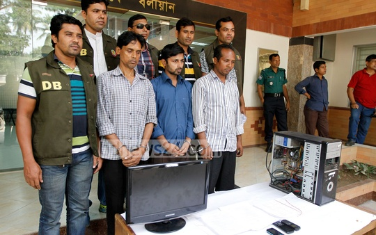 Detective police hold a briefing on Thursday where they presented before the media the three arrested over an Open Univesity question leak. Photo: asif mahmud ove/ bdnews24.com