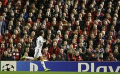 Real Madrid's Cristiano Ronaldo celebrates after scoring a goal against Liverpool during their Champions League Group B football match at Anfield in Liverpool, northern England October 22, 2014. Reuters