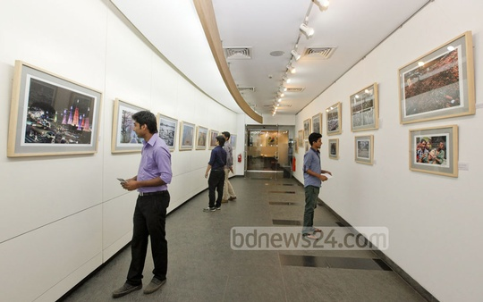 Visitors look around the photo exhibition, styled 'capturing bangladesh', held at Bay's Galleria in Gulshan on Saturday to mark bdnews24.com's eighth anniversary. Photo: bdnews24.com