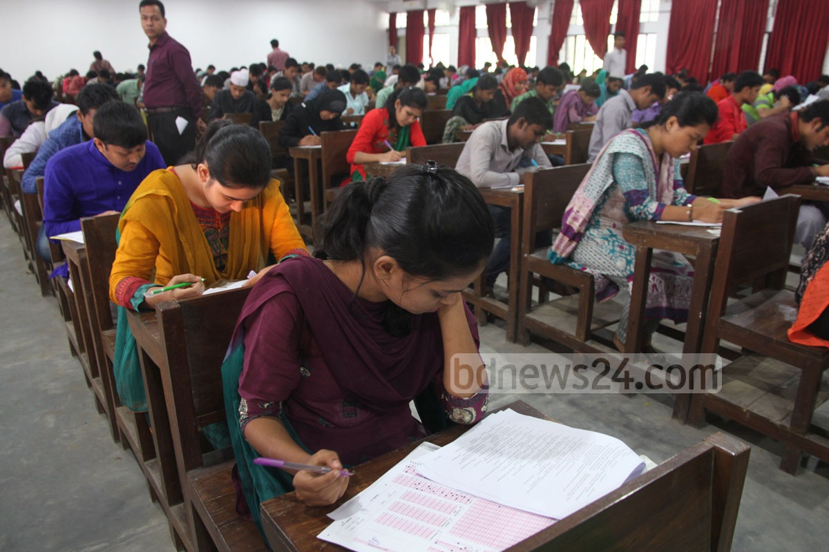 Students at the examination hall of the Chittagong University on the first day of the admission test for 2014-15 session on Monday. Photo: suman babu/ bdnews24.com