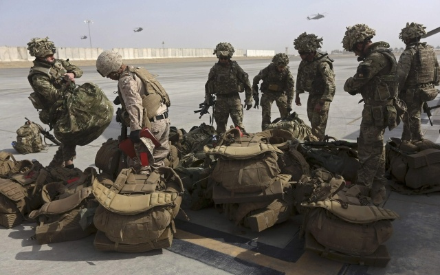 British soldiers arrive at Kandahar air base at the end of operations for US Marines and British combat troops in Helmand October 27, 2014. Reuters
