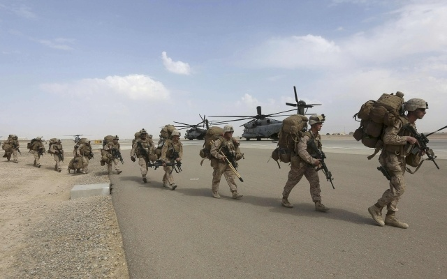 US Marines prepare to depart upon the end of operations for Marines and British combat troops in Helmand October 27, 2014. Reuters