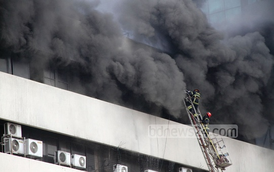 Fire-fighters try to douse a fire at the BSEC Bhaban in Karwan Bazar on Friday. Photo: asif mahmud ove/ bdnews24.com