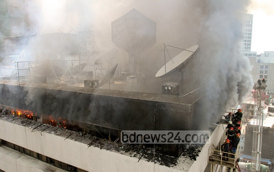 Fire-fighters try to douse a fire at the BSEC Bhaban in Karwan Bazar on Friday. Photo: tanvir ahammed/ bdnews24.com