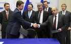 Russian Energy Minister Alexander Novak shakes hands with Ukraine's Energy Minister Yuri Prodan (R) after gas talks between the EU, Russia and Ukraine at the EC headquarters in Brussels Oct 30, 2014. Credit: Reuters