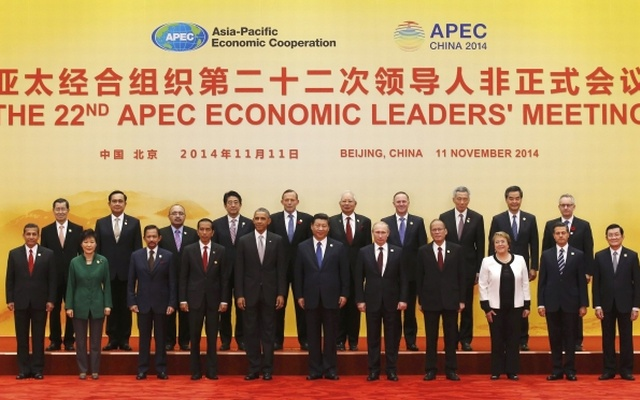 Asia Pacific Economic Cooperation (APEC) leaders pose for a family photo at the International Convention Center at Yanqi Lake in Beijing, November 11, 2014. REUTERS