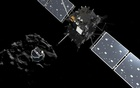 A handout artist impression showing lander Philae separating from the Rosetta spacecraft and descending to the surface of comet 67P/Churyumov-Gerasimenko, made available by the European Space Agency (ESA) on November 12, 2014. Reuters