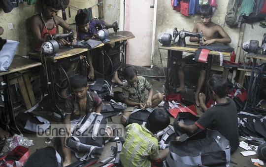 Children sew bagpacks at a factory in Bangshal in exchange of food and boarding. Photo: asif mahmud ove/ bdnews24.com