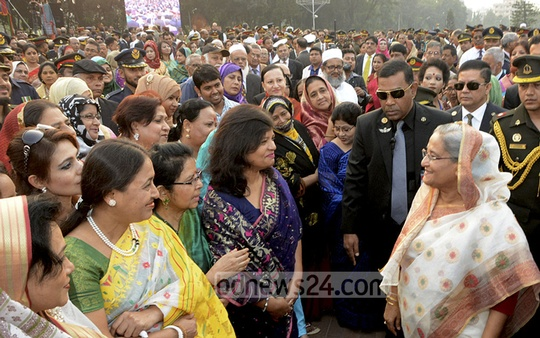Prime Minister Sheikh Hasina exchanges greetings with family members of army personnel at Senakunja on Friday at the Armed Forces Day function. Photo: Saiful Islam Kallol