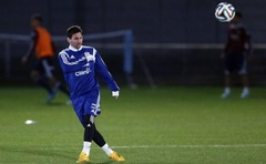 Lionel Messi kicks the ball during a training session at the Rush Green Stadium in Romford near London, November 11, 2014. Reuters