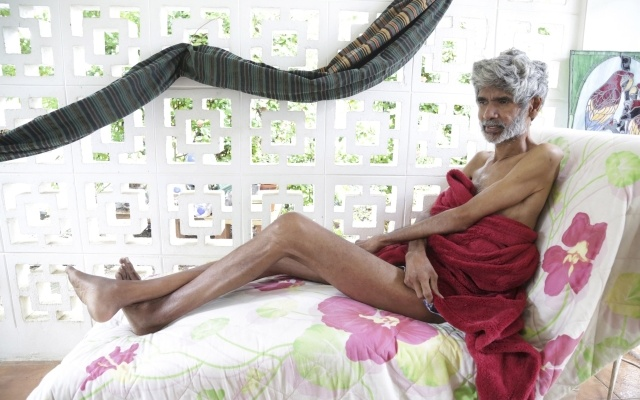Environmental activist Dr. Wayne Kublalsingh lies on a cot on the 65th day of his hunger strike, on the porch of his home in D'Abadie, northern Trinidad, November 20, 2014. REUTERS