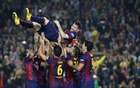 Barcelona's Lionel Messi celebrates his goal with teammates during their La Liga match against Sevilla at Nou Camp stadium in Barcelona November 22, 2014. Reuters