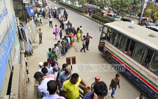 Pedestrians in Dhaka are standing in long queue to use foot over bridge in the capital's Banglamotor area. Fine has been imposed on crossing roads haphazardly without using the over bridge. Photo: bdnews24.com
