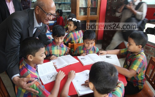 Education Minister Nurul Islam Nahid interacts with children of Fulki school in Chittagong on Wednesday. Photo: suman babu/ bdnews24.com