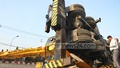 A crane overturns while removing illegal billboards in Chittagong's Customs More area. Photo: suman babu/ bdnews24.com