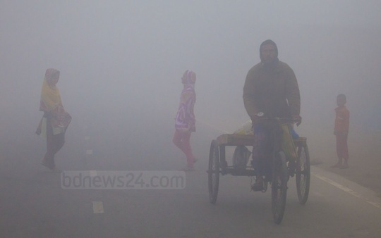 Dense fog heralding advent of winter. This photo of fog-covered Thakurgaon's Ranishonkoil area was taken on Thursday morning. Photo: asaduzzaman pramanik/ bdnews24.com