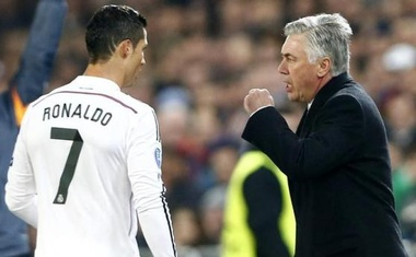 Real Madrid's coach Carlo Ancelotti (R) talks to Cristiano Ronaldo during their Champions League match against FC Basel at St. Jakob-Park stadium in Basel November 26, 2014. Reuters