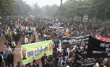 People throng the Martyred Intellectuals Graveyard at Mirpur in Dhaka marking the Martyred Intellectuals Day on Sunday. Photo: asif mahmud ove/ bdnews24.com