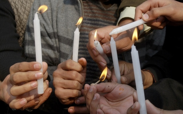 People light candles in memory of victims of the Taliban attack on the Army Public School, during a rally in Peshawar, December 17, 2014. REUTERS