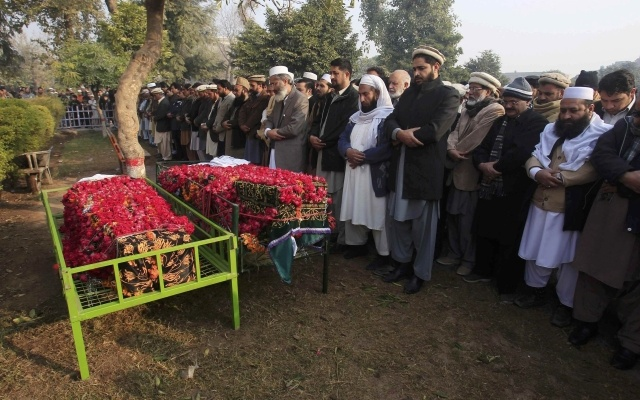 People attend funeral prayers for two male students who were killed in Tuesday's attack on the Army Public School, which was attacked by Taliban gunmen, before their burial in Peshawar, December 17, 2014. REUTERS