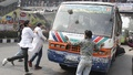 Agitated BSc Dental students vandalise a bus in front of the National Press Club on Wednesday. Photo: bdnews24.com