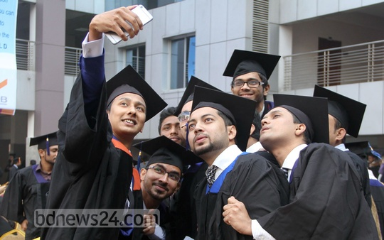 A group of graduate students taking selfie at IUB's 16th Convocation held at Dhaka's Bashundhara campus on Thursday. Photo: asif mahmud ove/ bdnews24.com