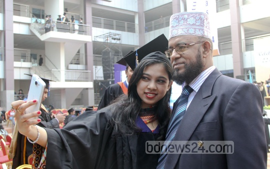 A successful graduate student takes selfie with her father at IUB's 16th Convocation held at Dhaka's Bashundhara campus on Thursday. Photo: asif mahmud ove/ bdnews24.com