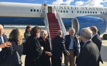 American aid worker Alan Gross (3rd R) disembarks with his wife Judy (4th L) from a US government plane as he arrives at Joint Base Andrews, Maryland outside Washington Dec 17, 2014 in this photo tweeted by US Senator Jeff Flake (R-AZ). Reuters
