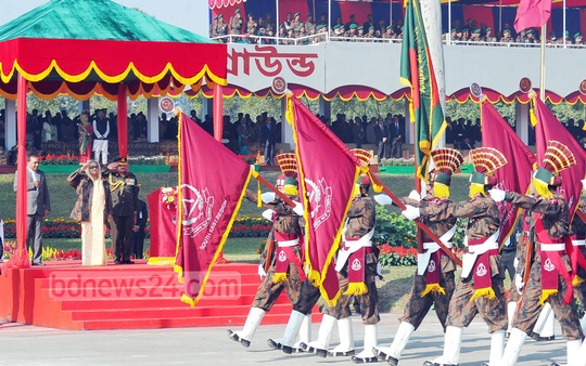 Prime minister Sheikh Hasina takes salutes at 'BGB Day-2014' in Dhaka's Peelkhana on Saturday. Photo: PMO