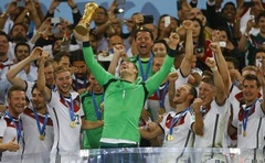Germany's goalkeeper Manuel Neuer lifts the Golden Glove at the end of the 2014 World Cup final between Germany and Argentina at the Maracana stadium. Reuters