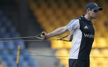 England's Eoin Morgan stretches during a practice session. Reuters