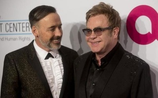 David Furnish (L) and Sir Elton John attend the Elton John AIDS Foundation's 13th annual An Enduring Vision Benefit in New York October 28, 2014. Reuters