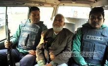 War criminal Syed Mohammad Kaiser is being taken to the prison after the death verdict. Photo: nayan kumar/ bdnews24.com