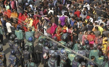 BNP supporters gather at Bakshibazar on Wednesday ahead of party chief Khaleda Zia's appearance in a court in connection with graft cases. Photo: asif mahmud ove/ bdnews24.com