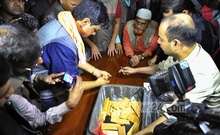 Customs officials and detective sleuths in a joint drive seize around 62kg gold and Tk 4 crore in national and foreign currencies from a house at Purana Paltan in Dhaka on Thursday. Photo: bdnews24.com