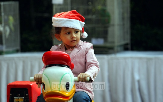 Children are partying at a Dhaka hotel to mark the Christmas Day on Thursday. Photo: nayan kumar/ bdnews24.com