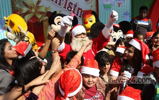 Santa Claus with children at a Dhaka hotel to mark the Christmas Day on Thursday. Photo: nayan kumar/ bdnews24.com