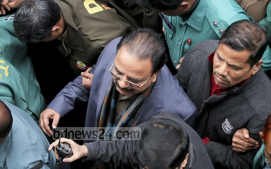 BNP leader Goyeswar Chandra Roy is being taken to CMM Court on Friday afternoon after he was arrested for alleged attempt on the life of Awami League MP Chhabi Biswas. Photo: tanvir ahammed/ bdnews24.com