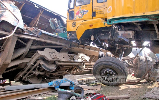 A train rams into a covered van near the Kamalapur rail container terminal, killing at least five people on Monday in Dhaka. Photo: tanvir ahammed/ bdnews24.com