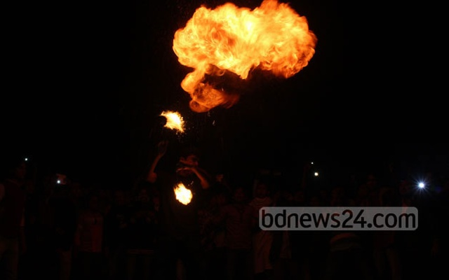 Youths revel at Dhaka University's TSC during celebrations to usher in the New Year Wednesday midnight. Photo: bdnews24.com