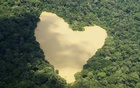 An aerial view of a natural lake fed by a spring in the Amazon River basin near Manaus, Sept 30, 2010. Reuters