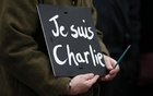A man holds a 'Je suis Charlie' sign during a march for the victims of the shootings by gunmen at the offices of the satirical weekly newspaper Charlie Hebdo in Paris, in Liverpool, northern England Jan 11, 2015. Reuters