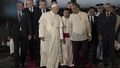 Pope Francis is greeted by Philippines' President Benigno Aquino (centre R) upon his arrival at Villamor Air Base for a state and pastoral visit, in Manila January 15, 2015. REUTERS