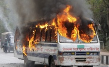 Miscreants set a bus on fire near Parliament complex in Dhaka during the BNP's blockade, leaving four students of Eden College injured. Photo: bdnews24.com